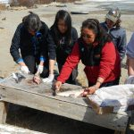 Teaching youth how to clean trout during the 2014 Culture Week in Nondalton